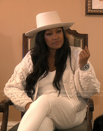 Garcelle's white chunky knit cardigan and backpack on The Real Housewives of Beverly Hills