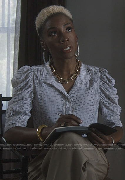The Chemist's white snake print puff sleeve top on American Horror Story