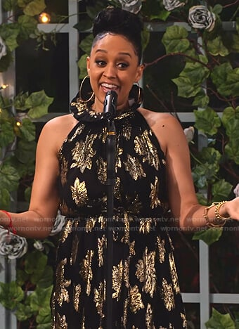 Cocoa's black and gold floral dress on Family Reunion