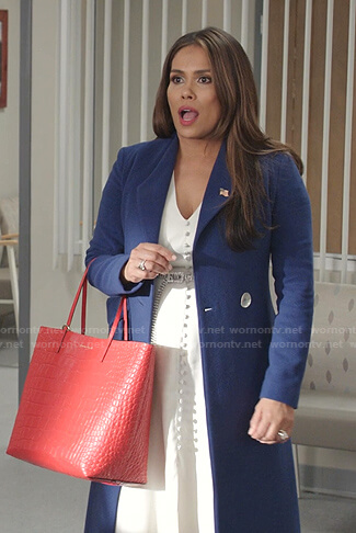 Cristal's blue coat and red tote bag on Dynasty