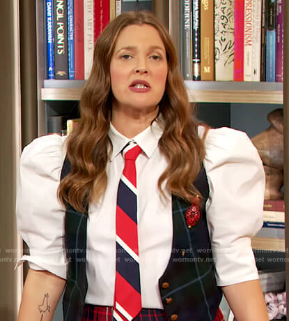 Drew's white puff sleeve blouse and plaid skirt on The Drew Barrymore Show