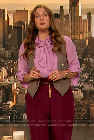 Drew's pink ruffle tie neck blouse and red pants on The Drew Barrymore Show