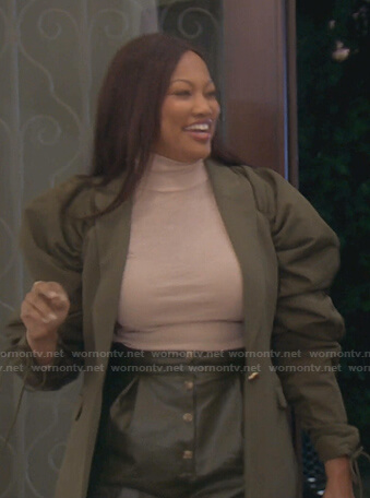 Garcelle's green puff sleeve jacket on The Real Housewives of Beverly Hills
