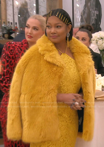 Garcelle's yellow floral lace dress and fur coat on The Real Housewives of Beverly Hills