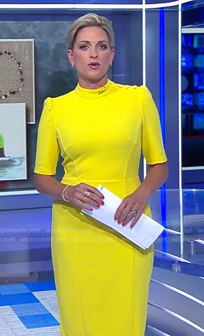 Jamie Yuccas's yellow button detail dress on CBS Evening News