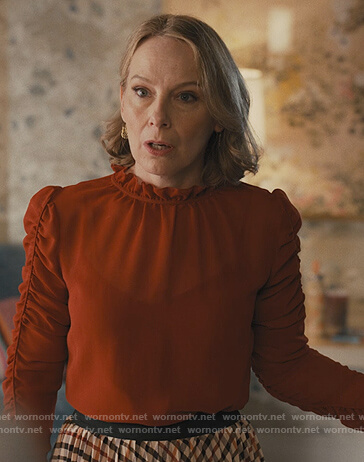 Jan's red ruched sleeve top on Only Murders in the Building
