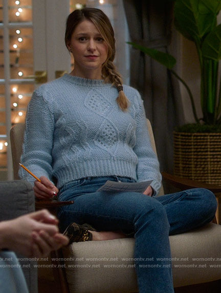Kara's blue cable knit sweater and plaid loafers on Supergirl