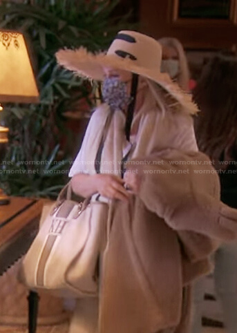 Kathy's straw hat and tote bag on The Real Housewives of Beverly Hills