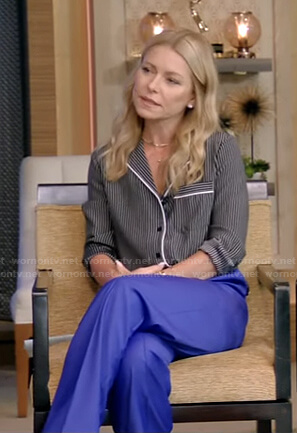 Kelly's black striped shirt and blue pants on Live with Kelly and Ryan