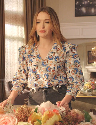 Kirby's white floral v-neck top and buckle denim skirt on Dynasty