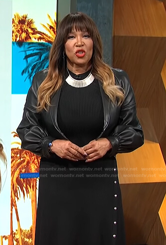 Kym's black ribbed dress and cropped leather jacket on E! News Daily Pop