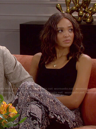Lani's black tank and floral wide leg pants on Days of our Lives: Beyond Salem