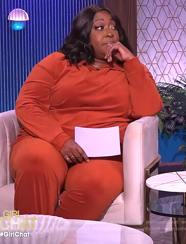 Loni's orange corduroy sweater and pants on The Real