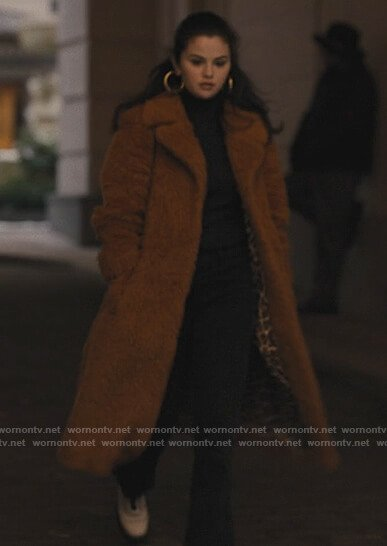 Mabel's fur coat and boots on Only Murders in the Building