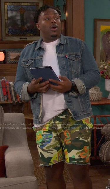 Tina's burgundy printed pants on The Neighborhood