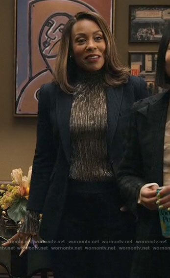 Stella's black checked blazer and pants on The Morning Show