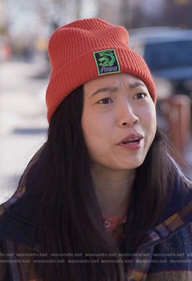 Nora's purple floral puffer jacket with pink and green stripes on Awkwafina is Nora From Queens