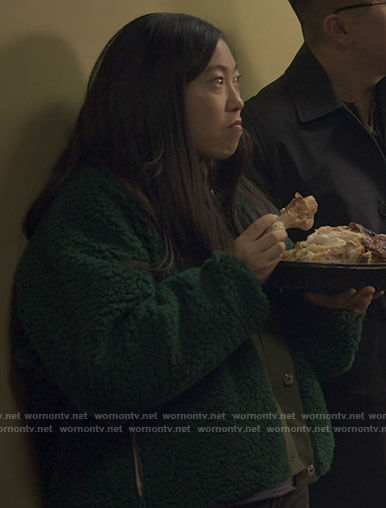 Nora's green fleece jacket on Awkwafina is Nora From Queens