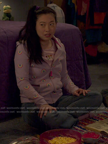 Young Nora's purple rainbow hoodie and flower top on Awkwafina is Nora From Queens