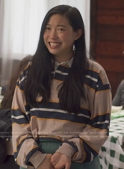 Nora's striped cropped polo shirt on Awkwafina is Nora From Queens