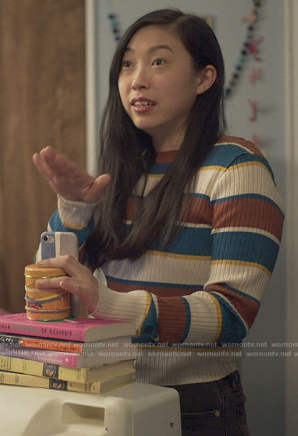 Nora's striped sweater on Awkwafina is Nora From Queens