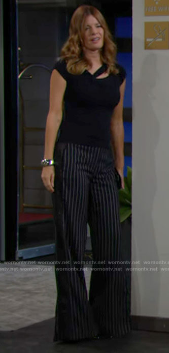 Phyllis's navy asymmetric cutout top and pinstripe pants on The Young and the Restless