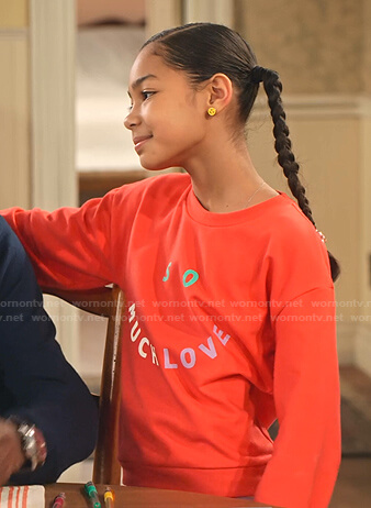 Ami's red So Much Love print sweatshirt on on Family Reunion