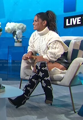 Rocsi Diaz's white cable knit sweater and studded boots on E! News Daily Pop