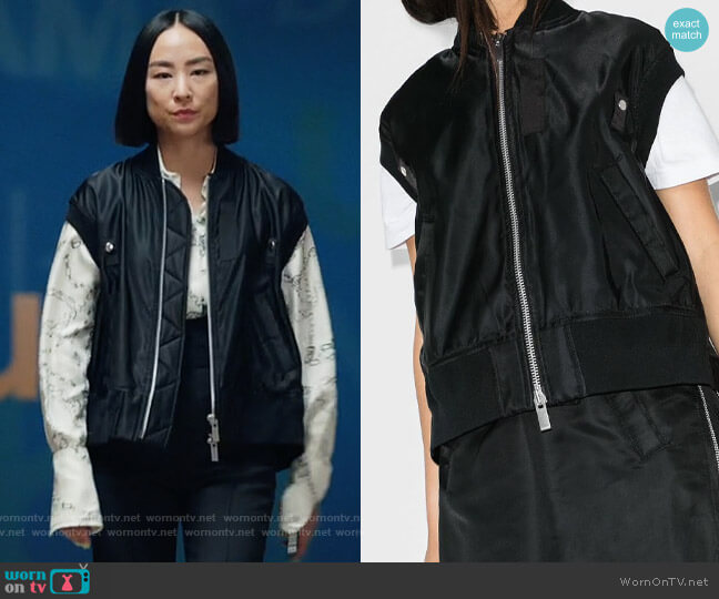 Sacai short-sleeve shell bomber jacket worn by Stella Bak (Greta Lee) on The Morning Show