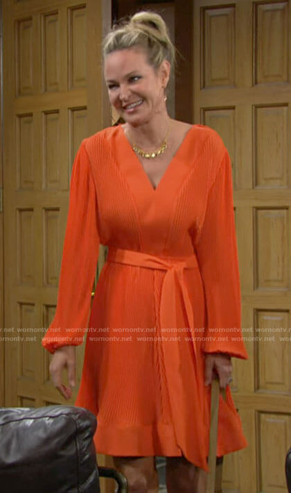 Sharon's orange long sleeve pleated dress on The Young and the Restless