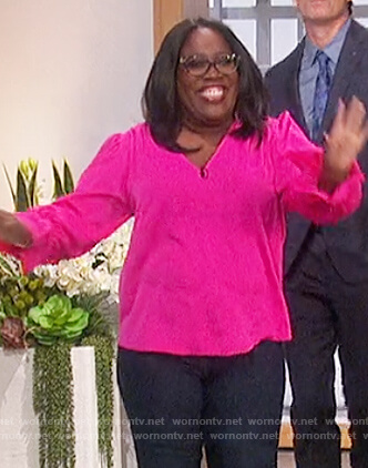 Sheryl's pink top with smocked cuffs on The Talk