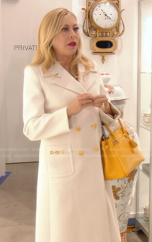 Sutton's white coat with gold buttons on The Real Housewives of Beverly Hills