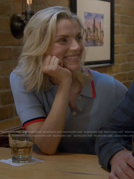 Sylvie's blue polo top with red trim on Chicago Fire