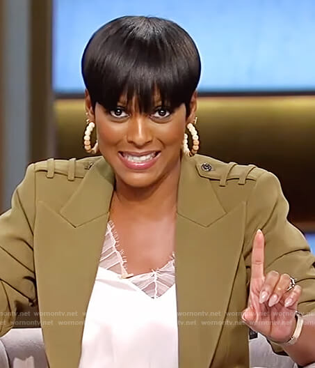 Tamron's green blazer and lace trim cami on Tamron Hall Show