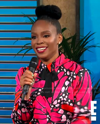 Amber Ruffin's pink butterfly print blouse on E! News Daily Pop