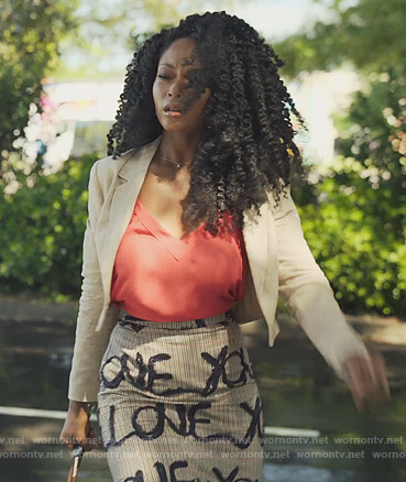 Angela's plaid Love print skirt on Our Kind of People
