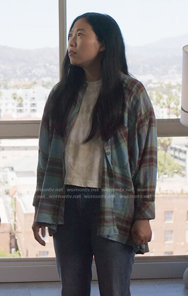 Nora's turquoise blue plaid shirt on Awkwafina is Nora From Queens