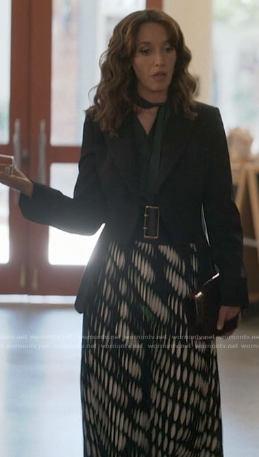 Bette's pleated trousers and black v-neck sweater on The L Word Generation Q