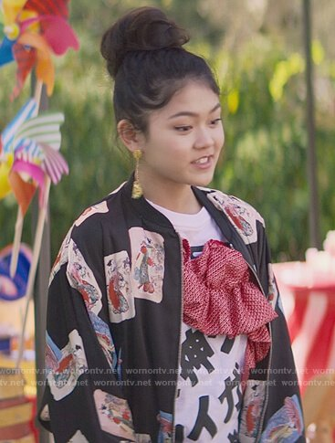 Claudia's black Japanese card print bomber jacket on The Baby-Sitters Club
