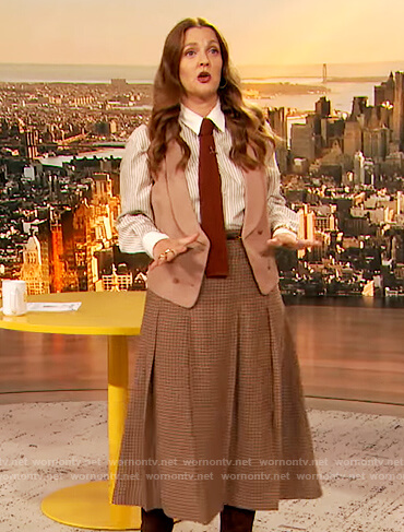 Drew's stripe blouse and check skirt on The Drew Barrymore Show