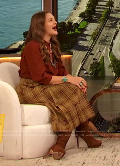 Drew's red silk blouse and plaid skirt on The Drew Barrymore Show