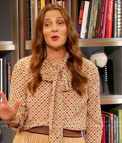 Drew's geometric print blouse and skirt on The Drew Barrymore Show