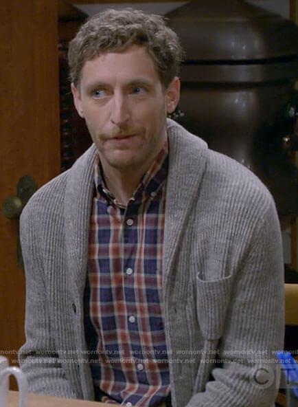 Drew's plaid shirt and grey cardigan on B Positive