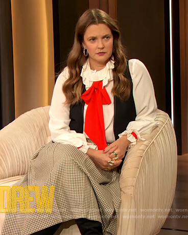 Drew's white contrasting blouse and check skirt on The Drew Barrymore Show