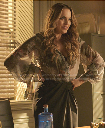 Fallon's tropical print blouse and black knotted skirt on Dynasty
