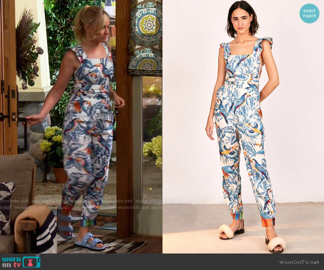 Farm Rio Flying Toucans Crossed Back Frilled Jumpsuit worn by Gemma (Beth Behrs) on The Neighborhood