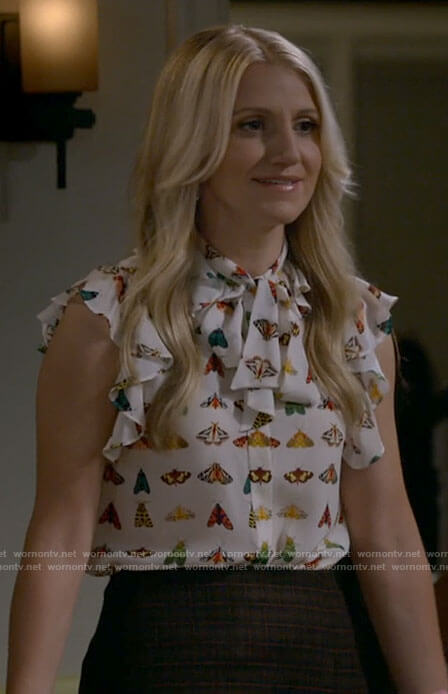 Gina's butterfly print top and plaid skirt on B Positive
