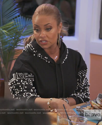 Gizelle's black pearl embellished sweater dress on The Real Housewives of Potomac