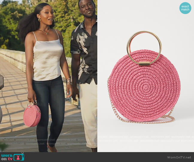 Round Straw Shoulder Bag by H&M worn by Angela Vaughn (Yaya DaCosta) on Our Kind of People