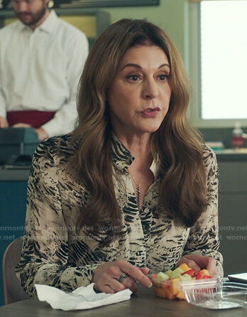 Kit's white abstract print blouse on The Resident